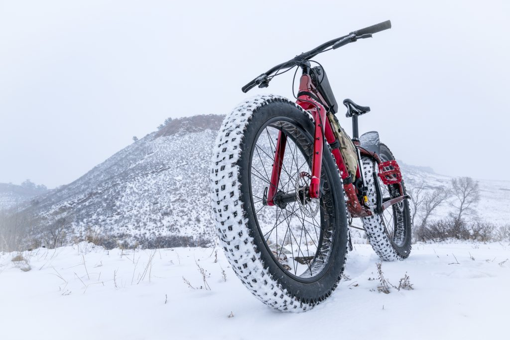 A mountain fat bike in a snow blizzard at Colorado foothills - Lory State Park near Fort Collins